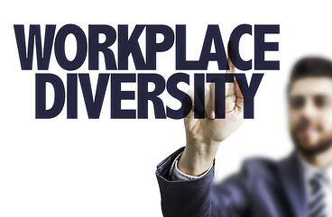 Business man pointing the text Workplace Diversity